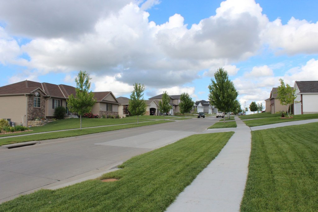 A view of some First Addition homes from the sidewalk